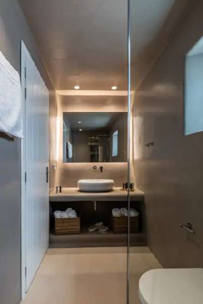 bathroom with glass shower and grey walls