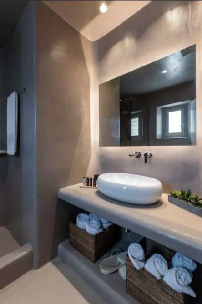 modern designed bathroom with ceramic sink and beautiful mirror