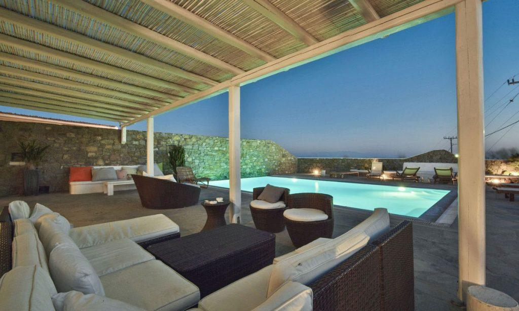 Villa-Aeneas-1_07.jpg Super Paradise Mykonos, outdoor, pool, sofa, pillows, chairs, table, sun bed, climbers, lights