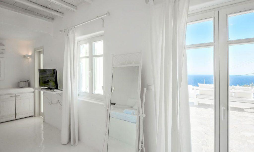 Villa-Aeneas-1_21.jpg Super Paradise Mykonos, living room, flat screen TV, mirror, curtains