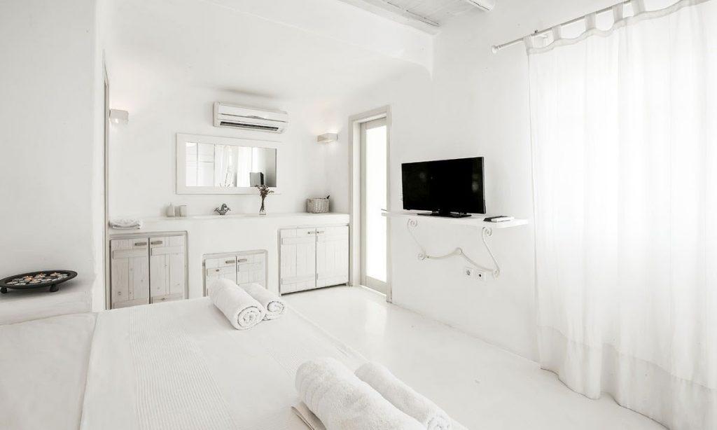 Villa-Aeneas-1_23.jpg Super Paradise Mykonos,, 3rd bedroom, king size bed, flat screen TV, towels, drawers, mirror, AC, curtain