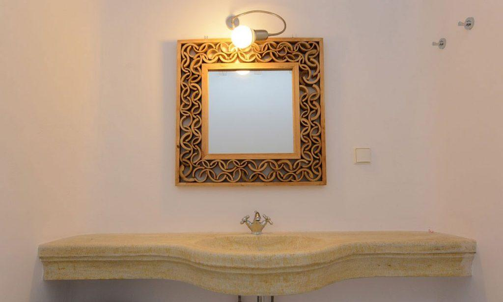 Golden mirror frame with golden washstand