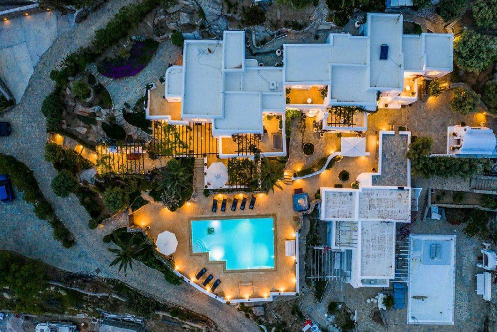 view from above on a beautifully lit villa and spacious yard