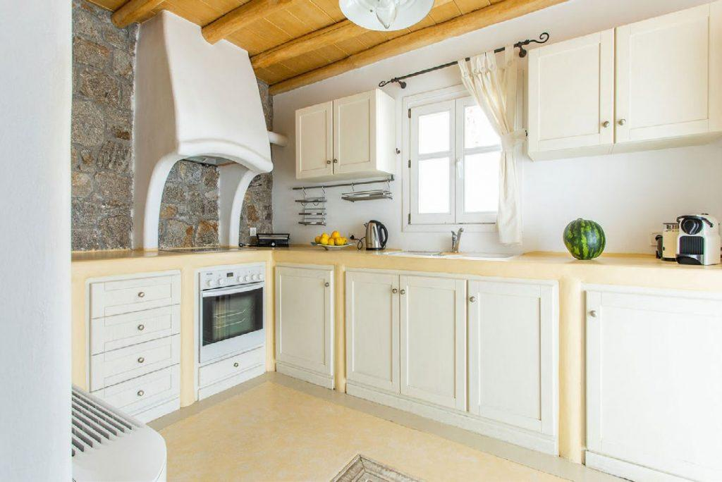 kitchen with wooden white cabins and coffee maker