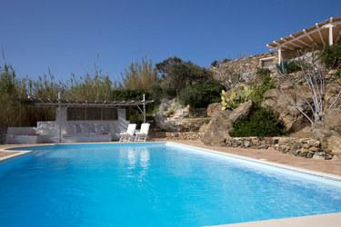 Villa Cleo, Lia, Mykonos, Pool, Stone wall, Bech chairs, Sky