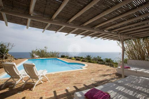 Villa Cleo, Lia, Mykonos, Pool, Stone wall, Bech chairs, Sea view, Sky
