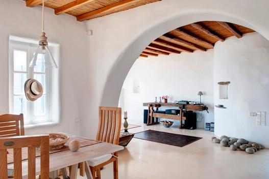 Villa Denys, Agios Stefanos, Mykonos, Chairs, Table, Lamp, Hat, Window, White wall, Stones