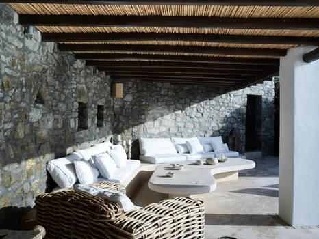 Villa Elie, Agios Lazaros, Mykonos, Sofa, Pillows, Stone wall, Table, Balcony