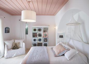 Villa Elie, Agios Lazaros, Mykonos, Master bed, Pillow, Chair, Lamp, Pictures, White wall