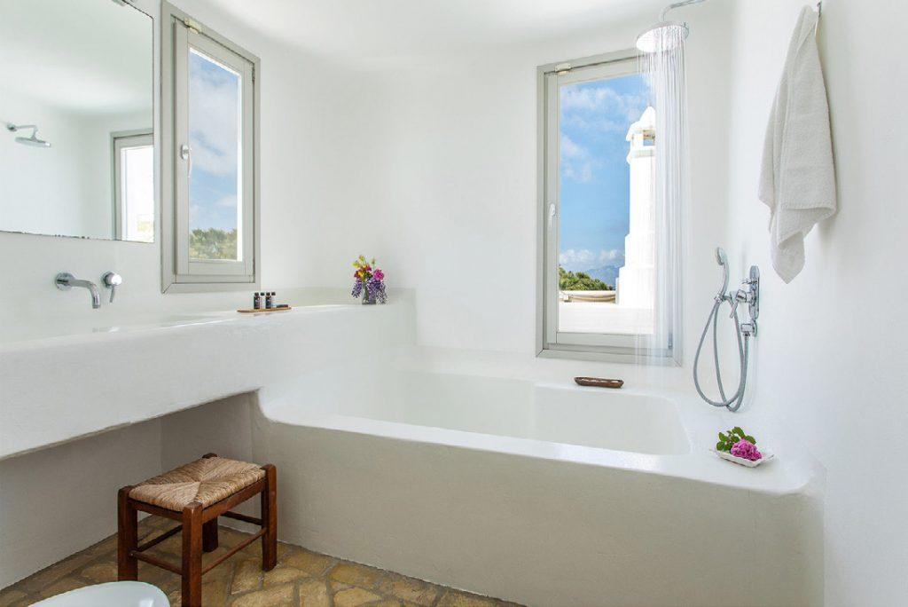 white bathroom with view of outside perfect for relaxing