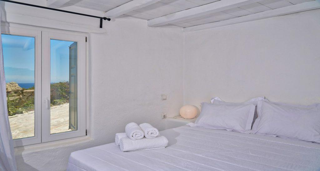 Villa-Futura_18.jpg Pirgi Mykonos 5th Bedroom, window, curtains, bed, pillows, lamp, night table