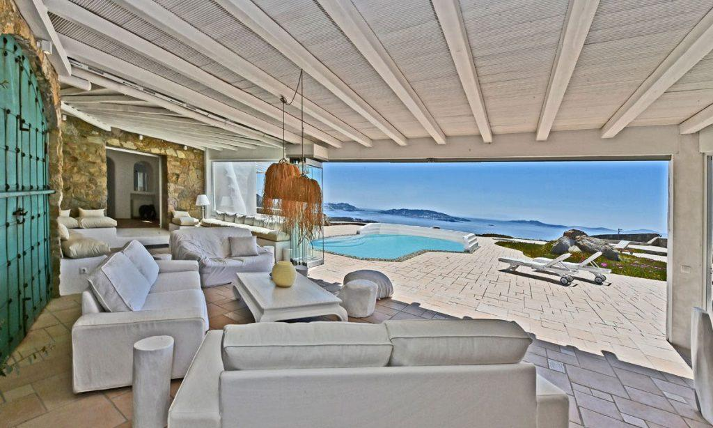 living area with white furniture and stunning outdoor view