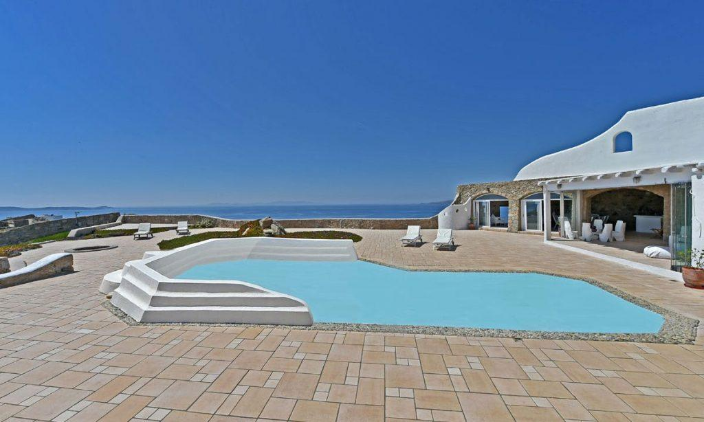 outdoor area with pool and breathtaking horizon sea view