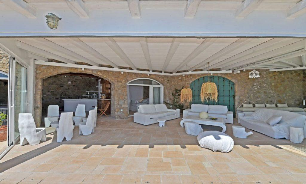 outdoor spacious living area with white theme furniture