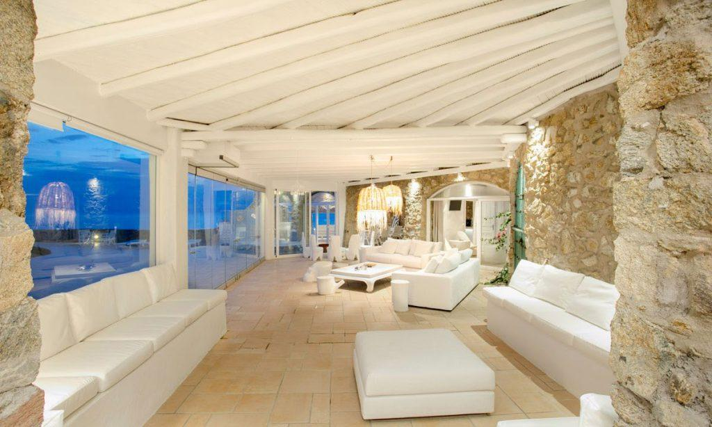 spacious living area with white furniture and beautiful chandelier