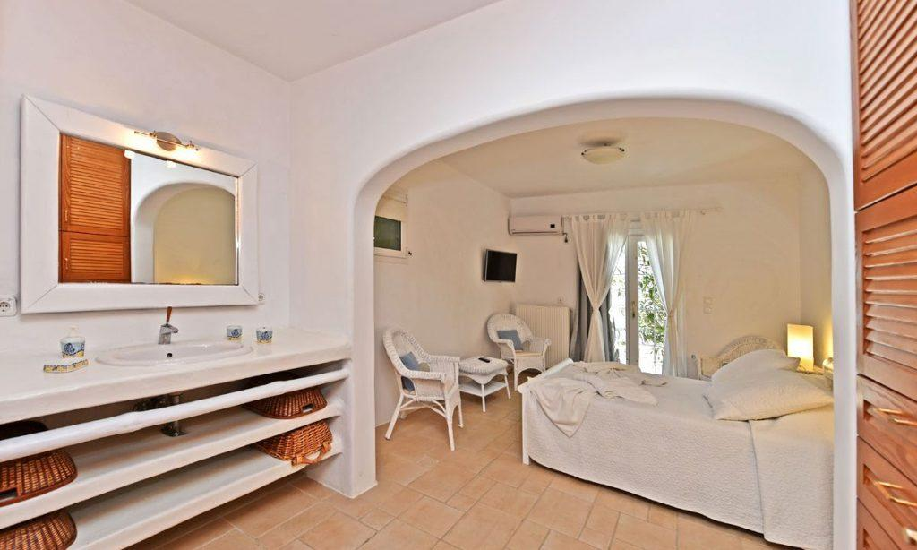 bedroom with double bed and white frame mirror