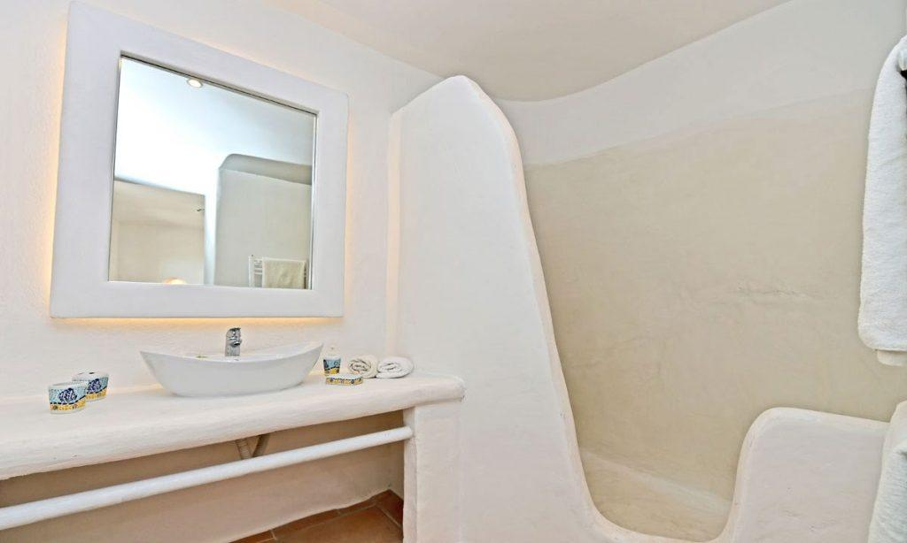 bathroom with illuminated mirror and shower