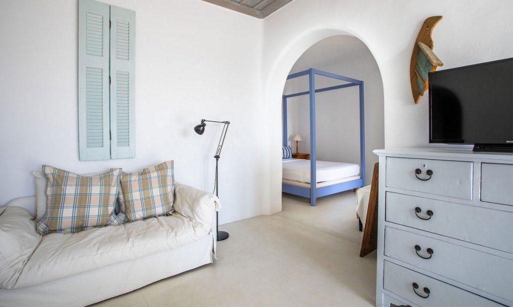 Villa-Greta_07.jpg Tourlos Mykonos 4th Bedroom, flat screen tv, cabinet, lamp, bed, pillows
