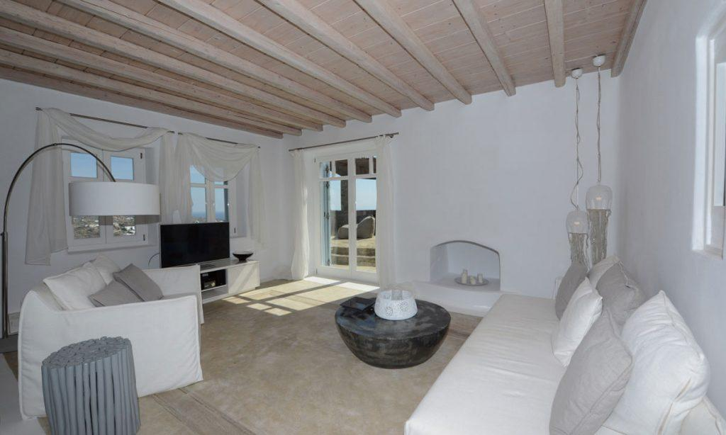 Villa Icarus I, Psarrou, Mykonos, Sofa, Lamps, Tables, Flat screen TV, Windows, Doors, Outdoor view, Fireplace, Living room