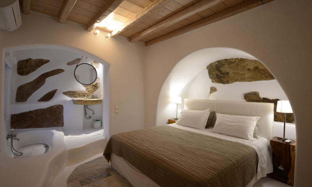 Villa Icarus I, Psarrou, Mykonos, Master bed, Lamps, Closet, Stone wall, Mirror, Shower, Sleeping room, Bathroom