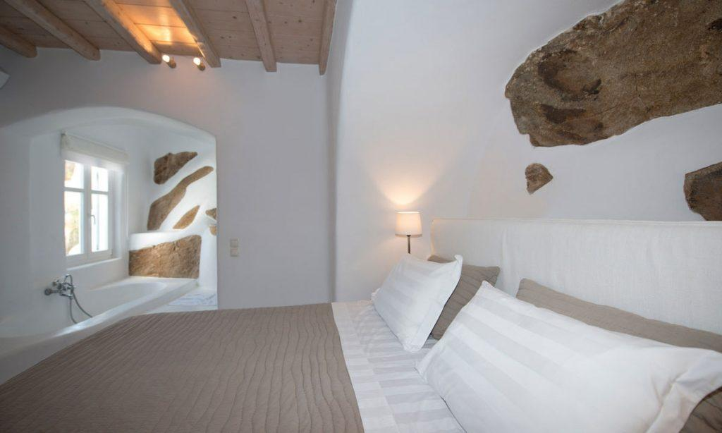 Villa Icarus I, Psarrou, Mykonos, Master bed, Lamps, Stone wall, Shower, Sleeping room, Bathroom