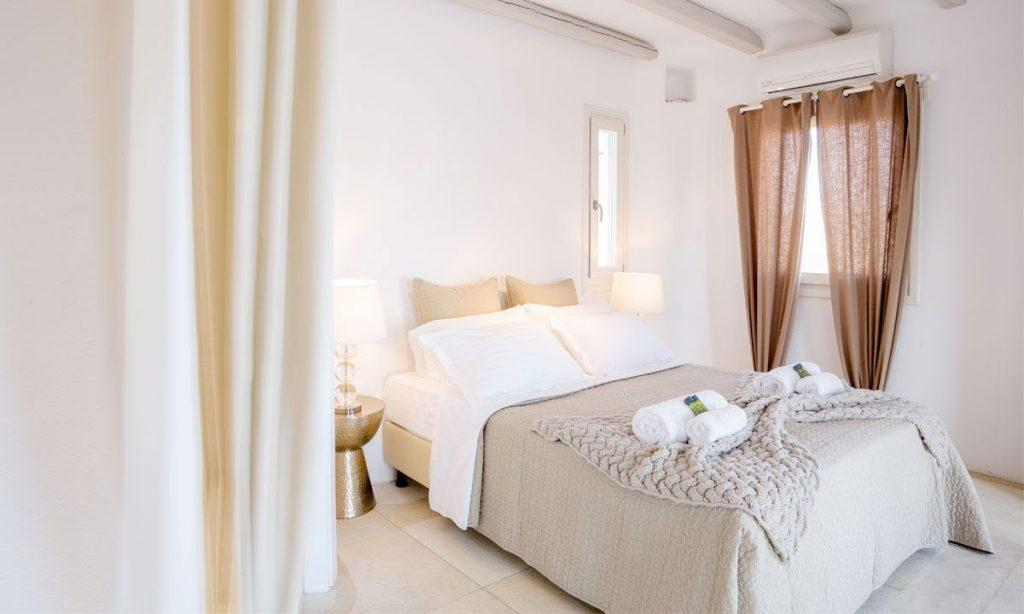 Villa Ida, Super Paradise, Mykonos, Bed, Master bed, Chairs, Curtains, Pictures, Table, Lamps, Pillows, Towels, Windows, A/C
