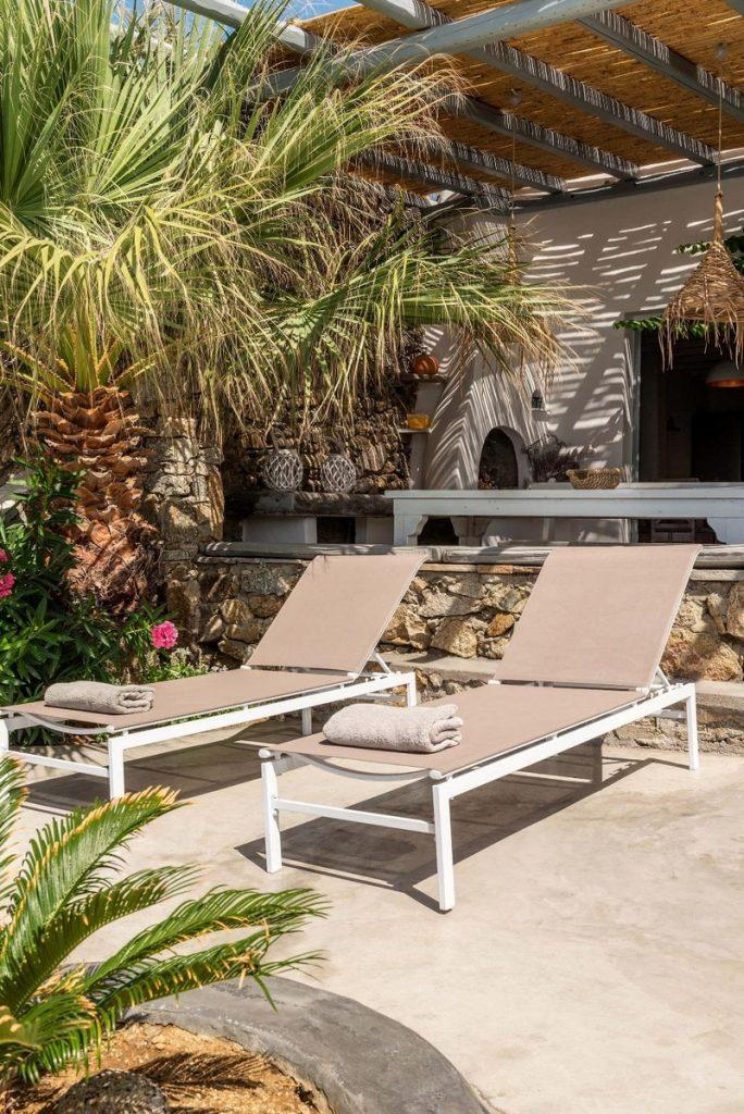 outdoor area with palms and flowers perfect for relaxing