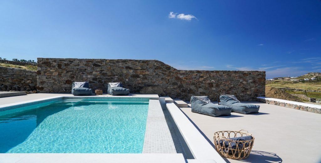 outdoor area with climbers for sunbath and pool