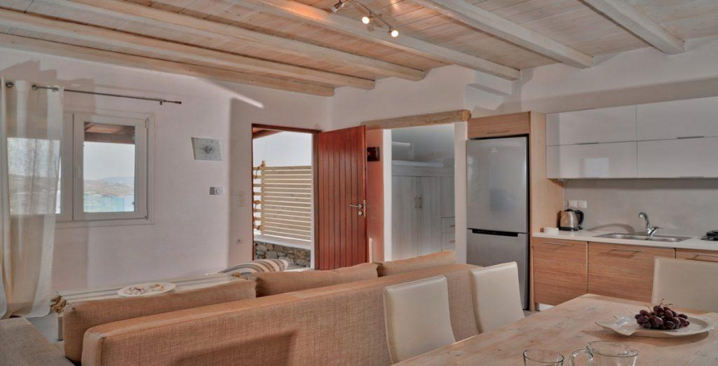 dining area with beauty wooden and white cabins