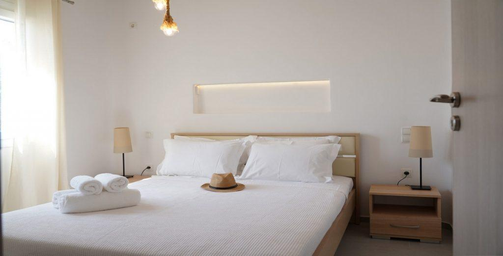 modern designed bedroom with wooden bed frame and soft pillows