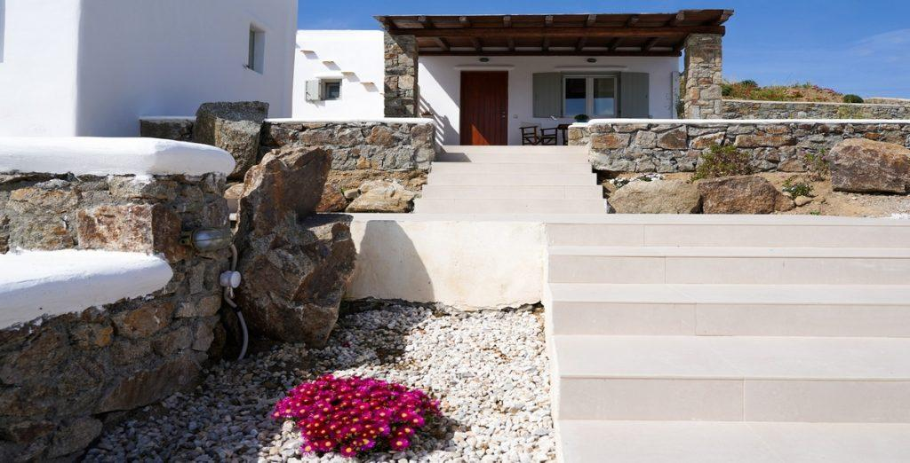 outdoor area with tiled stairs and flowers which stands out
