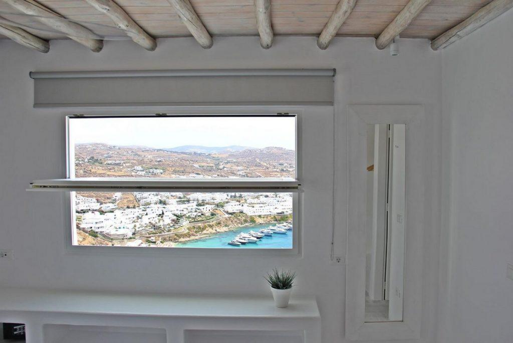 room with beautiful view of Mykonos city and sea