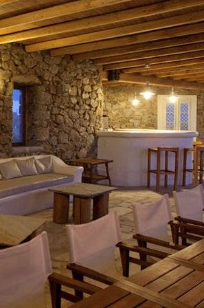 Villa-Kyros_03.jpg Super Paradise Mykonos, outdoor, sofa, pillows, table, bar, high chairs, dining table, chairs