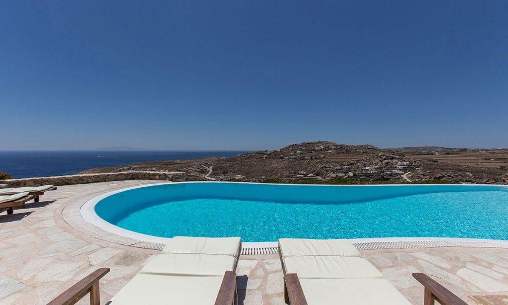 stunning view of sea and mykonos from the pool