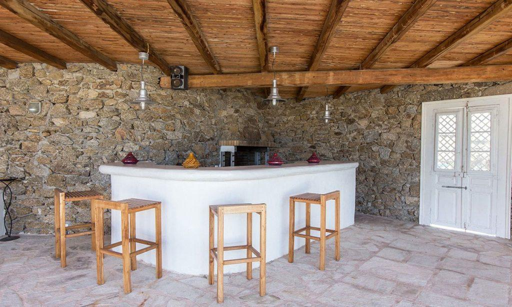 Villa-Kyros_11.jpg Super Paradise Mykonos, outdoor, bar, high chairs, door, stone wall