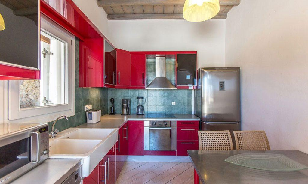 modern designed kitchen in red theme for cooking food of making coffee