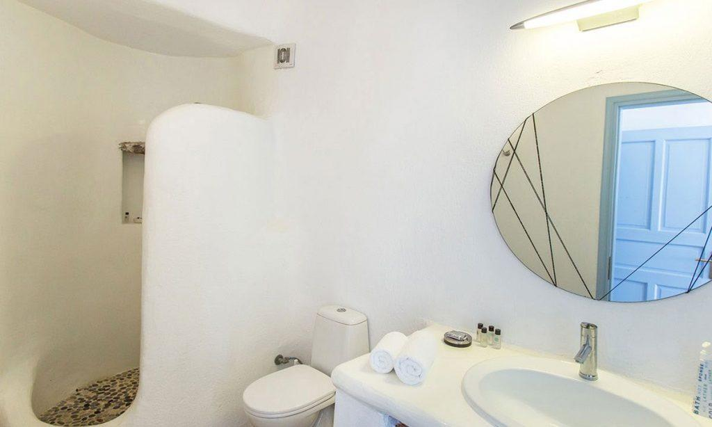 white bathroom with shower and sink for bathing and tidying up