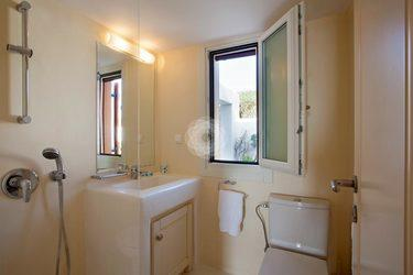 Villa-Lois_07.jpg Aleomandra Mykonos, 1st bathroom, washstand, mirror, toilet, towel, shower, window