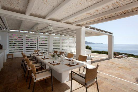 Villa-Lois_14.jpg Aleomandra Mykonos, outdoor dining area, dining table, plates, chairs, forks, knives, spoons, sea, sky