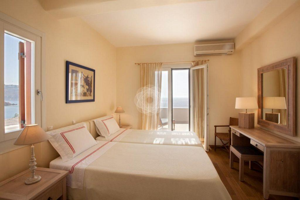 Villa-Lois_19.jpg Aleomandra Mykonos, 1st bedroom, double bed, pillows, lamps, nightstands, mirror, AC, chairs, painting