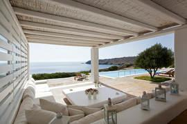 Villa-Lois_23.jpg Aleomandra Mykonos, outdoor, sofa, pillows, table, candles, sea, sky, pool