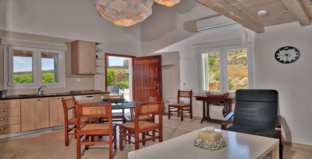 spacious area with dining table and wooden cabins