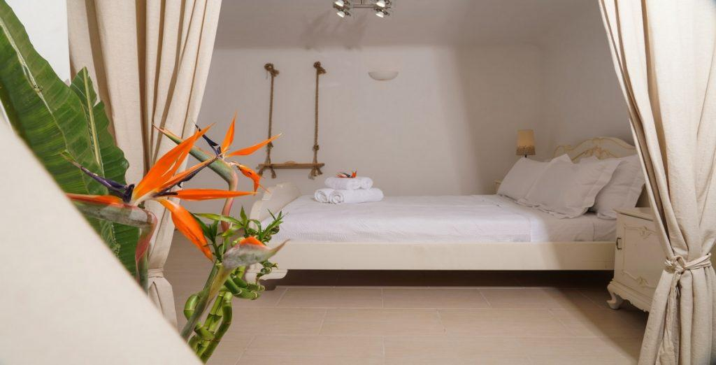 bedroom with white sheets and flowers for more comfortable atmosphere
