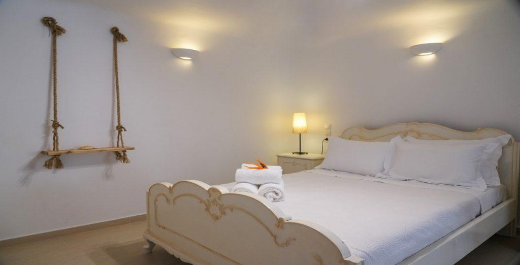 simply designed room with wall lamps and swing