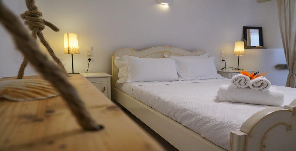 bedroom with double bed and lamps all over the room