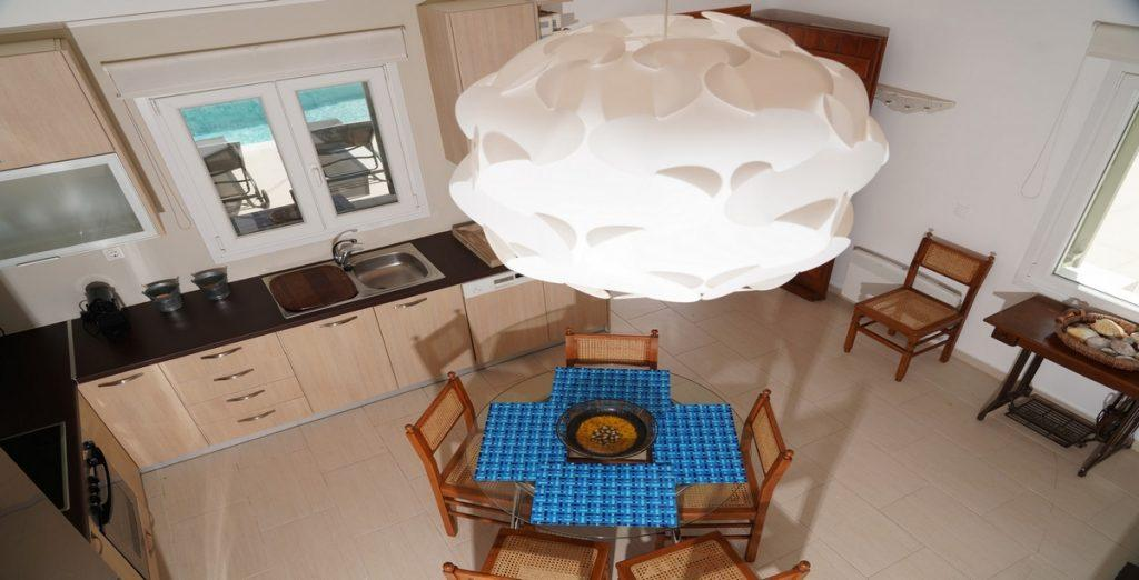 view of the kitchen from a bird's view with unusual chandelier