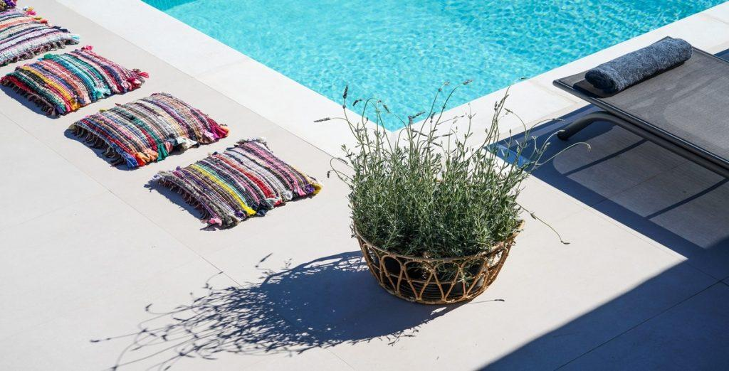 outdoor area near pool with cozy pillows and climbers