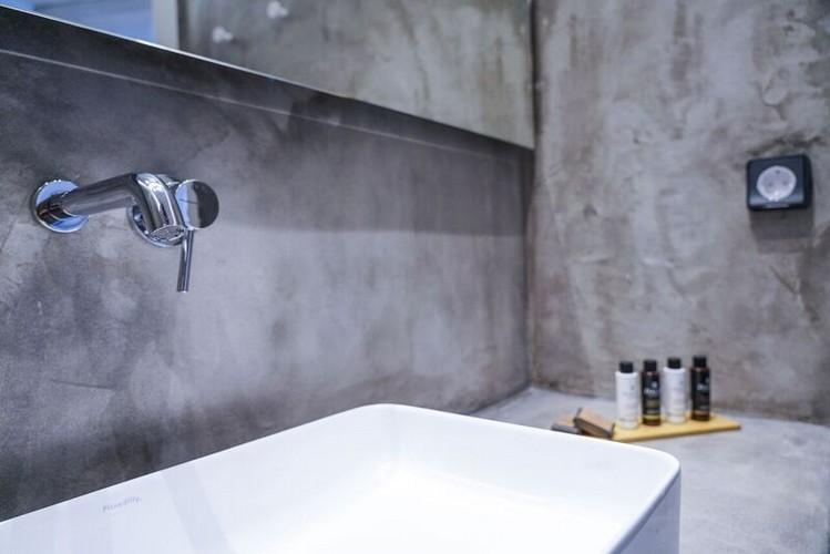 grey wall bathroom with sink and soup