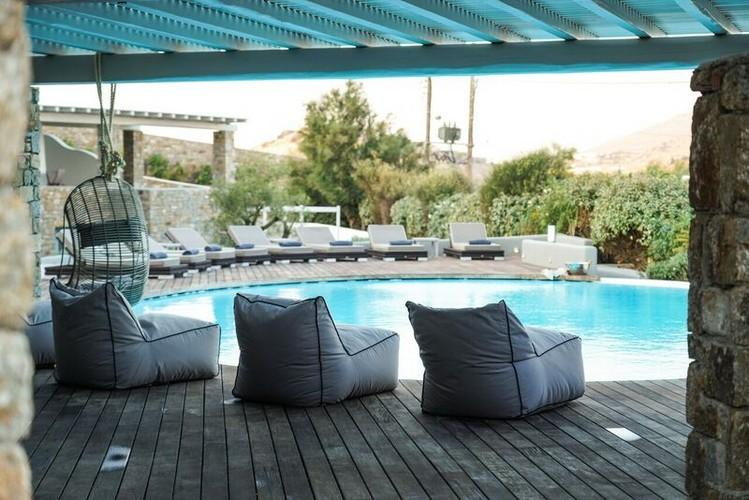 outdoor area with climbers to relax in and pool for swimming
