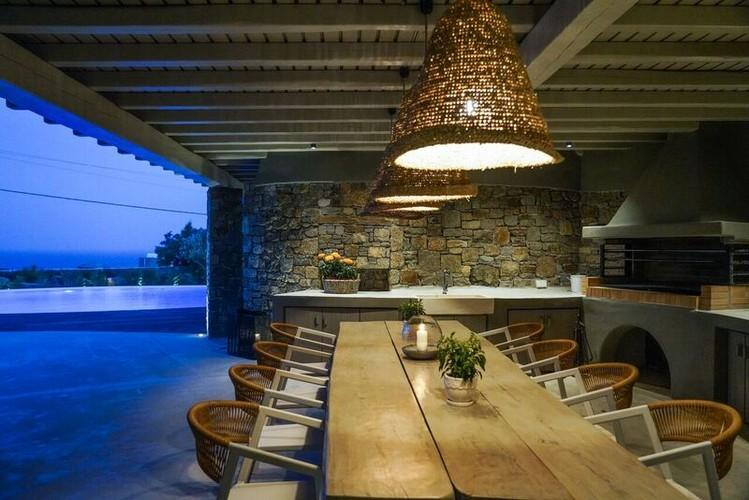 outdoor dining area pleasantly illuminated with lamps and candles